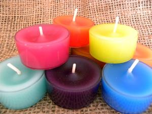Hand poured tea lights come in many colours and scents.